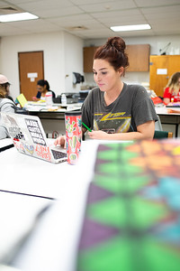 Student Sarah Keller conducts research before working on a non-proportional color study inventory for her Color Theory class.