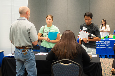 Students talk with representatives from the Drug Enforcement Agency during the Veterans, Criminal Justice, and Government Agencies Expo.