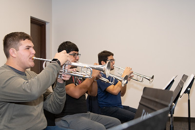 Joshua Rowe (left), Dustin Hernandez, and Tlaloc Pernles practicing their trumpets in the Center for the Arts building.