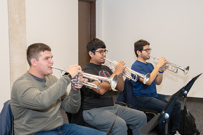 Joshua Rowe (left), Dustin Hernandez, and Tlaloc Pernles practicing their trumpets in the Center for the Arts.