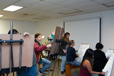 Students work on their individual still life portraits during Drawing I in the Center for the Arts.