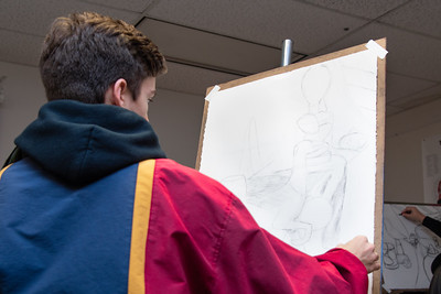Carson Bourque working on his still life for Drawing I in the Center for the Arts.