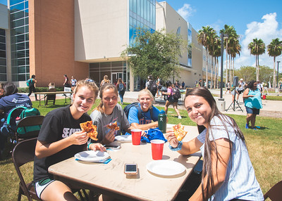 Jaedyn Johnson (left), Alex Shipp, Marina Davidson and Reaghan Lang sit down in between classes at the UC East Lawn for some free pizza hosted by Baptist Student Ministry (BSM).