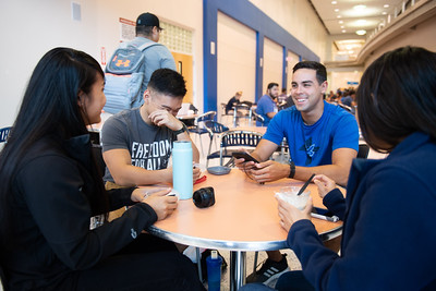 Eden Urbina (left), Vincent Lising, Tyler Hensley, and Tuyet Ho catch up on the second day of the fall 2018 semester.