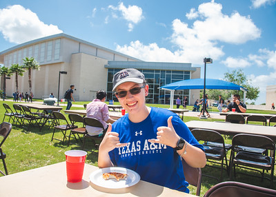 Megan Rodriguez shows off her Islander spirit as she sits down at the UC East Lawn for free pizza hosted by Baptist Student Ministry (BSM).