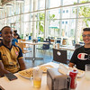 Students Clancy Tse (left) and Michael Rodriguez have lunch at the Islander Dining Hall.