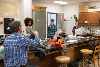 Rachel Klose (Red Plaid Shirt), Ryan Rubino (Blue Plaid Shirt), Bryanna McClendon (Gray Shirt) and Dr. John Scarpa (Blue Plaid Shirt) - Dr. John Scarpa Graduate class works on balancing the solute levels between the cooler of shirmp and their new home in the tank.