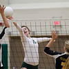 Record-Eagle/Jan-Michael Stump<br /> Traverse City Central's Brie Goodno (9) tries to block Traverse City West's Courtney VanHouzen (10) in Tuesday's district volleyball match
