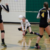 Record-Eagle/Jan-Michael Stump<br /> Traverse City West's Katie Placek (11) bumps the ball in Tuesday's district volleyball match against Traverse City Central.