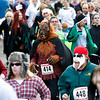 Record-Eagle/Jan-Michael Stump<br /> Bruce McHaney (414) of Grace Harbor takes off at the start of the third annual Zombie Run 5k Saturday in Traverse City.