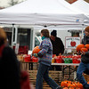 Record-Eagle/Jan-Michael Stump<br /> Virginia Roberts, of Traverse City, gets help carrying pumpkins to her car from Michael Popp-Trevino, of Popp Farms in Omena, on at the last Sara Hardy Farmers Market of the year in Traverse City.
