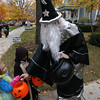 Record-Eagle/Keith King<br /> Katie Venhuizen, left, 6, dressed as a mermaid, and her brother, Luke Venhuizen, 7, dressed as Luke Skywalker, receive candy from John Zaloudek, dressed as a wizard.