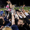 Record-Eagle/Jan-Michael Stump<br /> Traverse City St. Francis players celebrate with their trophy following Friday's 29-12 district final win over Mancelona.