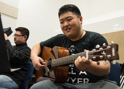 Weiya Wang practices during Basic Guitar II in the Center for the Arts Building.