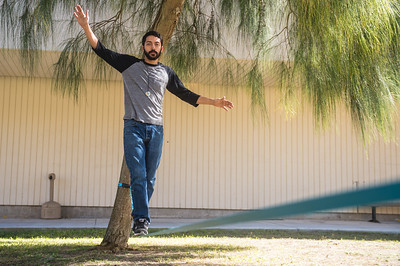 Dillon Reyes keeps his balance as he makes his way across a slack line.