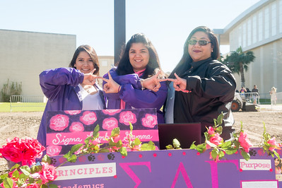 Laura Niaves (left), Brittany Trevino, and Sofia Flores pause for a photo at their Sigma Lambda Gamma table set up on the East Lawn.