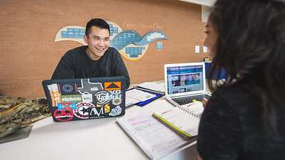 Robert Nguyen and Mayra Gonzalez catch up on school work in the University Center's Tejas Lounge.