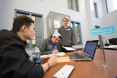 Silvio Detore (center) is assisted with his Calculus 3 work by CASA tutors Hoang Nguyen (left) and Spencer Swanson(right).