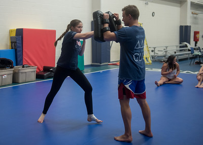 Alexis Mitchell practices with Kai Malzer during a Mixed Martial Arts Club meeting.