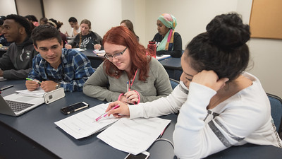 Aaron Perez(left), Rebecca Ethridge, and Jasmine Rodriguez collaborate during their genetics class.