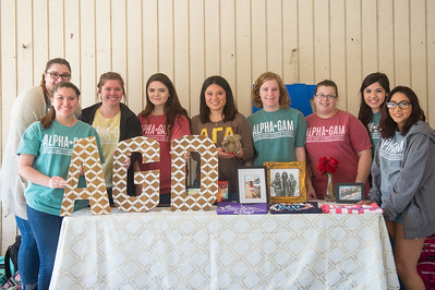 Alpha Gamma Delta sets up in the breezeway during an afternoon on campus.