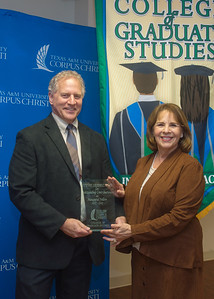 Dr. Steve Seidel receives an outstanding contribution award from Dean Canales during the Graduate Awards Luncheon.