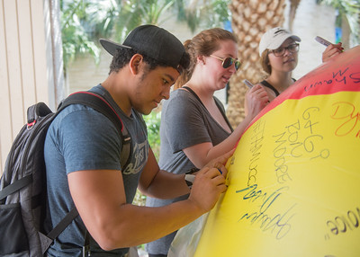 Students are welcomed to write on a free speech beach ball around campus.