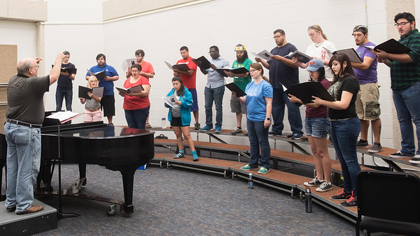 TAMUCC Dr. Ross Bernhardt directs a composition of music in the center for arts building.