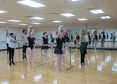 Professor Jilissa Cotten demonstrates different positions during her Ballet I class.