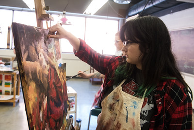 Elizabeth Sneed diligently works on her art during her Intermediate Painting class.