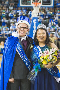 The Islander Homecoming King and Queen pose for a photo on the basketball court. Frank Gallegos and Alissa Ramirez.