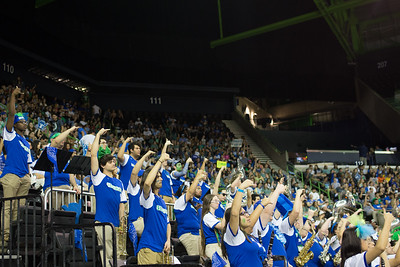 The Islander Pep Band hold their shakas up high during a free throw attempt.