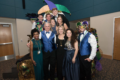 President Ambassadors pose with Dr. Albrecht and Dr. Quintanilla during the 2017 President's Mardi Gras Ball in the University Center.