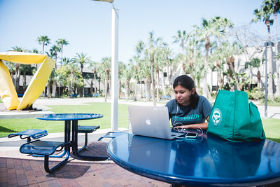 Jasmine Lopez enjoys another beautiful day at the Island University as she surfs the web in the Center of Instruction Plaza area.