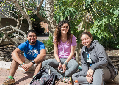 Students Giuseppe Lara (left), Ericka Cruz, and Ana Rodriguez relax between classes.