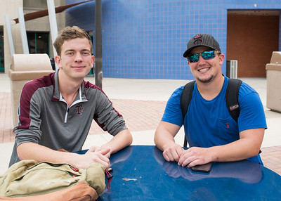 Students Carlton Daggett and Aaron Sallock relaxing in the Center for Instruction courtyard.