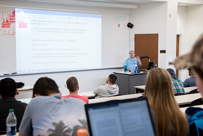 Professor Edward Roeder reviews with his class what will be on their next exam.