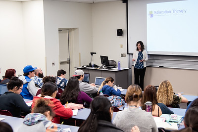 Dr. Houlihan lectures her class on the importance of stress management.