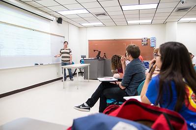 Sean Britt assists students prepare for an essay during a US History seminar class.