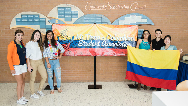 Students with the Colombian Student Association present their Mi Tierra event in the University Center.