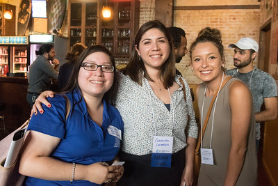 Olivia Santos (left) and Casandra Lorentson pose for a photo with a prospective student intern during the COMM Week Networking Mixer at House of Rock.