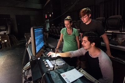 Students Savannah Stirling (left), Austin Nylander, and Christopher Niesner work on programming lights for TAMUCC Theatre's production of Cloud Nine, opening on Tuesday, April 18.