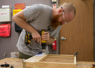 James Allen works on building a toolbox.