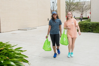Maddie Warren (left) and Irma Elizondo smile for a photo while taking part in the Walk A Mile in Her Shoes event.
