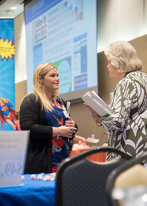 Sarah Kopecky speaks to a representative with Gregory-Portland ISD during the Careers in Education Fair held in the University Center.