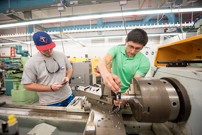 Morgan Miller (left) and Patrick Garcia work on their capstone senior design project in the Engineering lab.