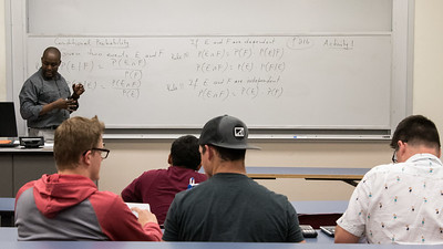 Professor Nene Coullbaly instructs his class on conditional probability in Business Mathematics.
