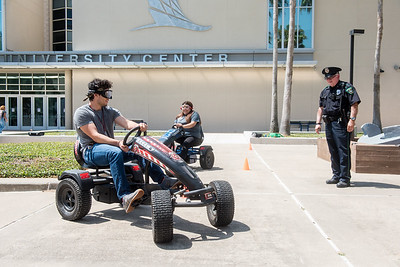 Jacob Dalton (left) and Rebekah Ramirez attempt to navigate around the UC Anchor with goggles that impair their vision.