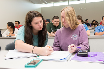 Peyton Fussee-Durham (left) and Angela Newton work together on their Managerial Accounting assignment.