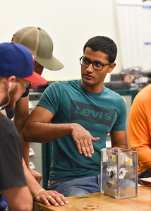 Student Rohan Gill brainstorms with his peers on their Engineering Capstone project.